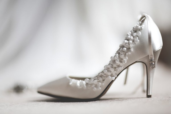 Bridal shoe with flower detail