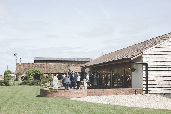 Wedding guests outside Quantock Lakes