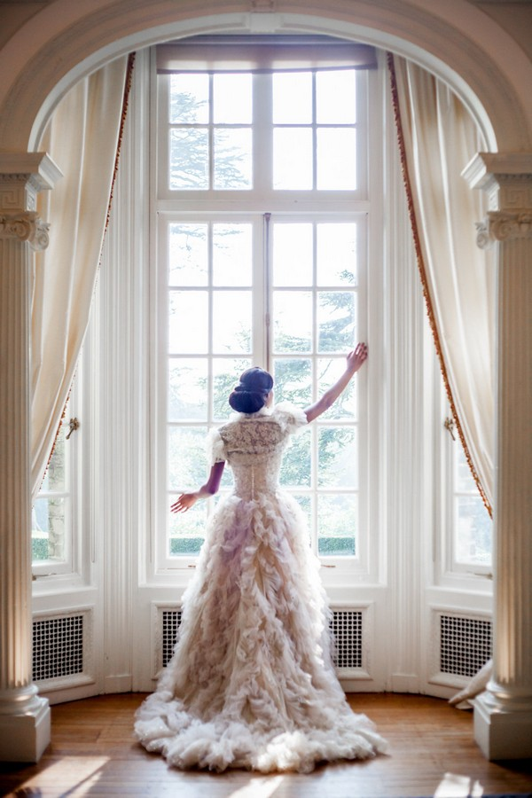 Bride standing at window at Hedsor House