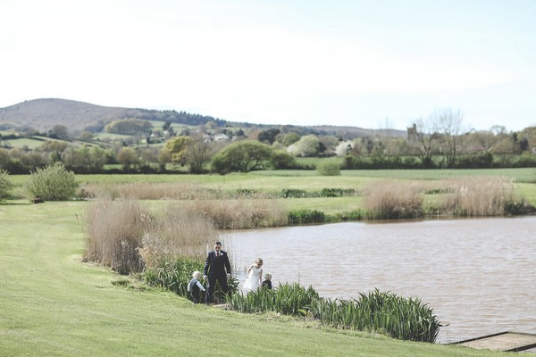 Wedding guests by lake at Quantock Lakes