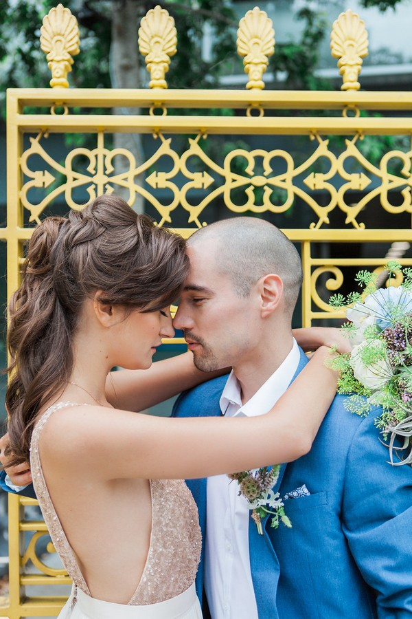 Bride with arms around groom's neck