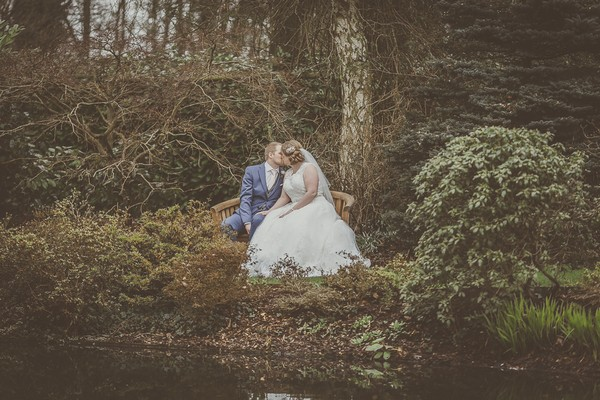Bride and groom in grounds of Rivervale Barn
