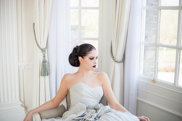 Bride with chignon sitting in chair