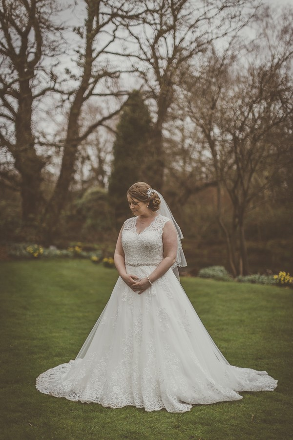 Bride in grounds of Rivervale Barn