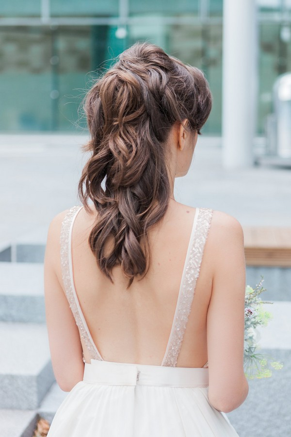 Bride's messy half up half down hairstyle