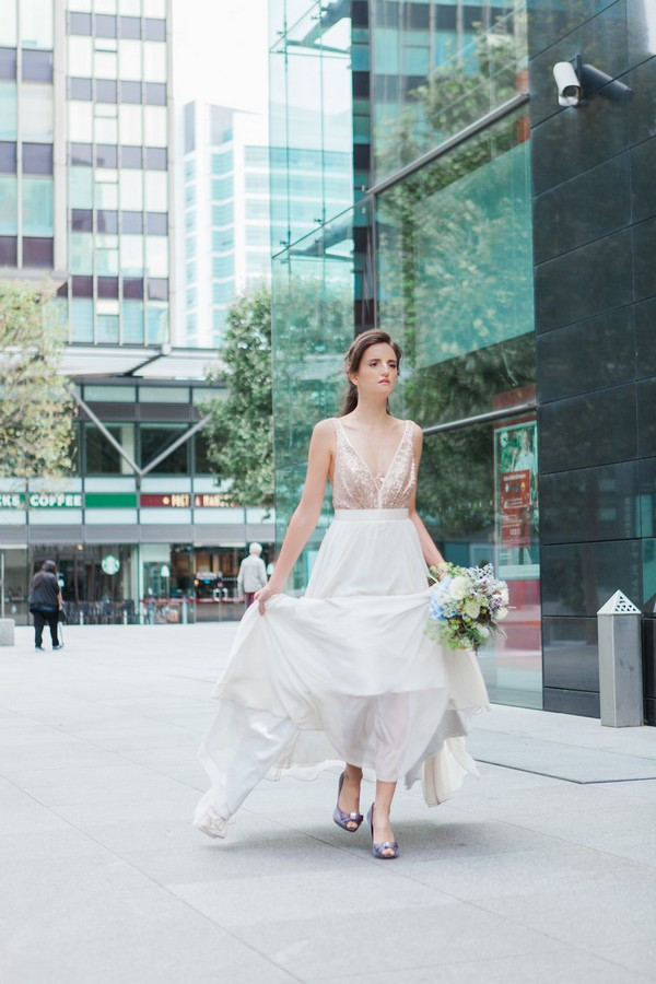 Bride walking through streets