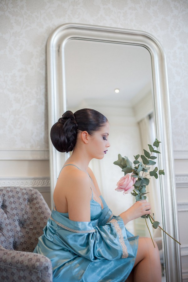 Bride sitting wearing blue dress