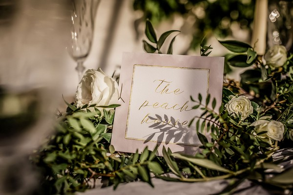 The Peach House sign on wedding table