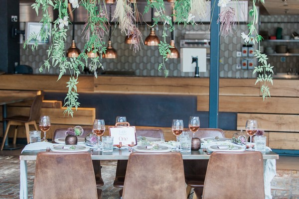 Wedding table with foliage hanging above