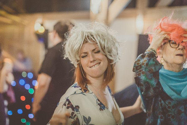 Wedding guest dancing with wig on