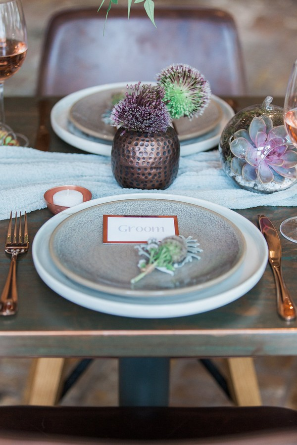 Copper and botanical wedding place styling