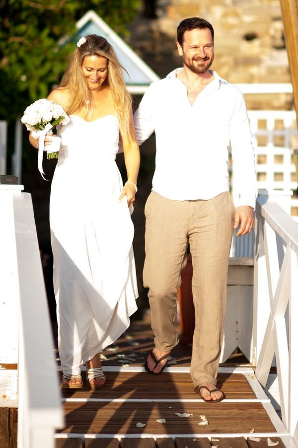 Groom Wearing Open Shirt and Linen Trousers for Beach Wedding