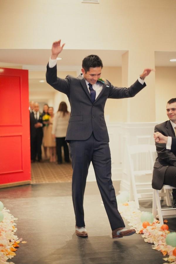 Groom in Smart Wedding Suit Entering Ceremony