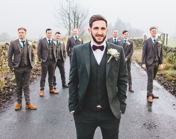 Groomsmen in coordinating suits and different ties