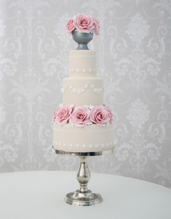 Light Beige Coloured Wedding Cake with White Piping and Flowers
