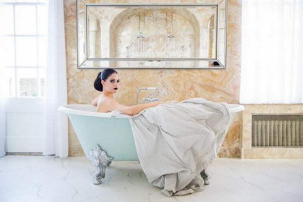 Bride sitting in bath tub