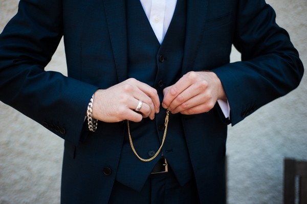 Groom Doing Up Buttons on Plain Navy Blue Waistcoat