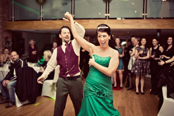 Groom Wearing Purple Waistcoat with Bride in Green Dress
