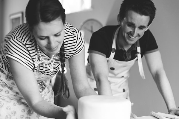 Couple Re-Icing Top Tier of Wedding Cake