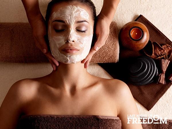 Woman having facial in spa