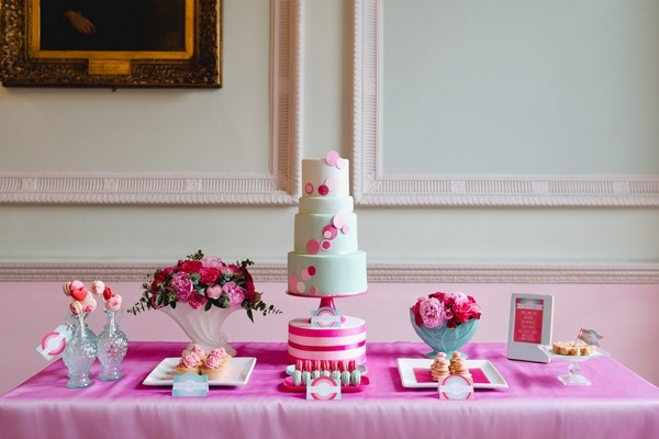 Wedding Cake Table with Pink Tablecloth