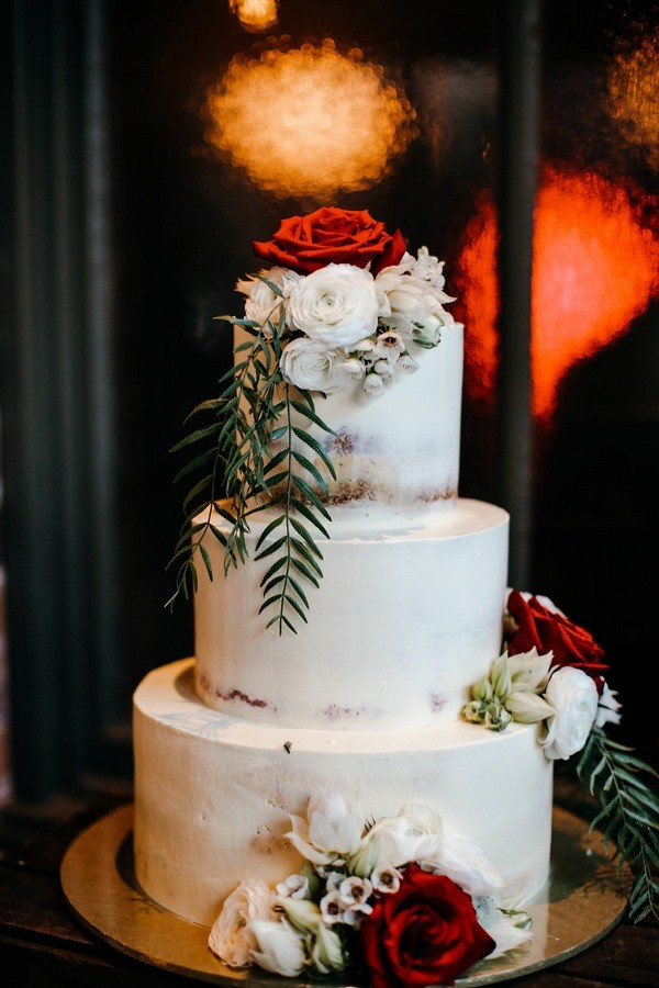 White Wedding Cake Decorated with Fresh Flowers