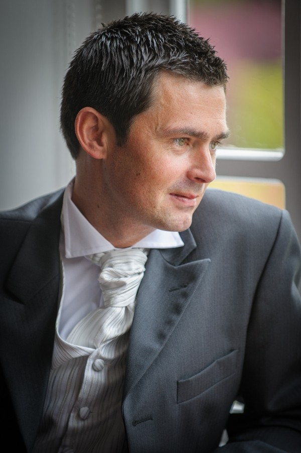 Groom Wearing White and Silver Striped Waistcoat and Cravat