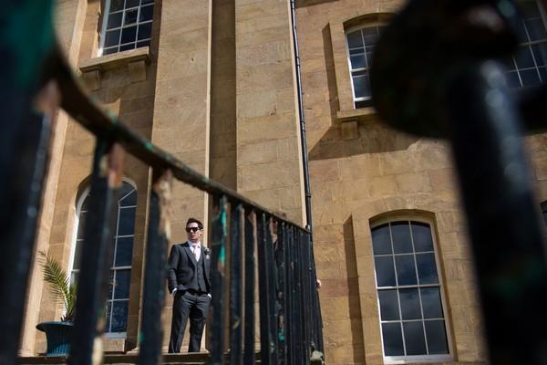 Groom outside Kings Weston House