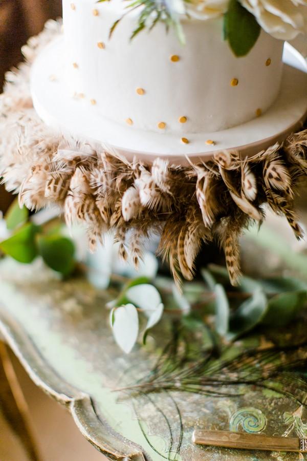 Feathers on bottom of wedding cake
