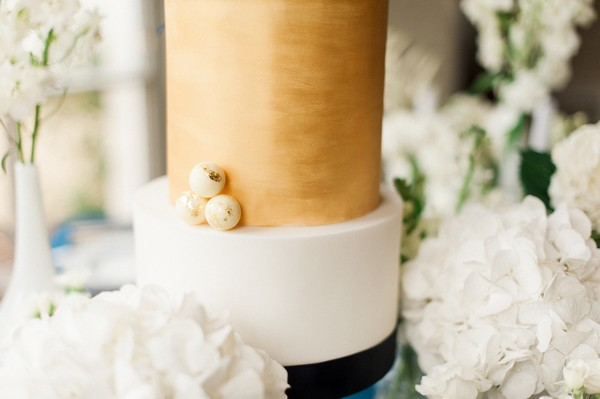 Detail on blue and gold wedding cake