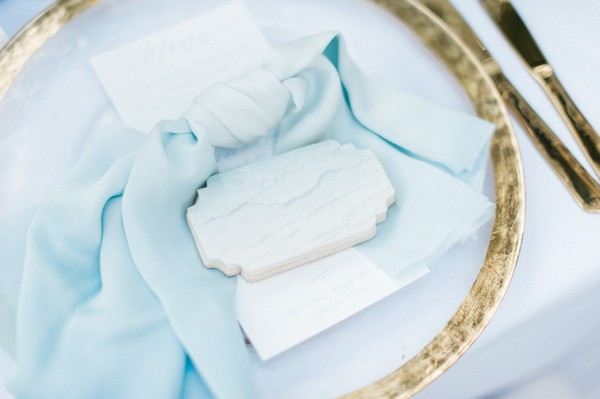 Plate and blue napkin at wedding place setting