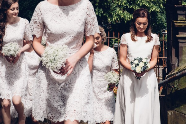 Bride walking with bridesmaids to church