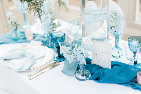 Blue table runner and styling on wedding table