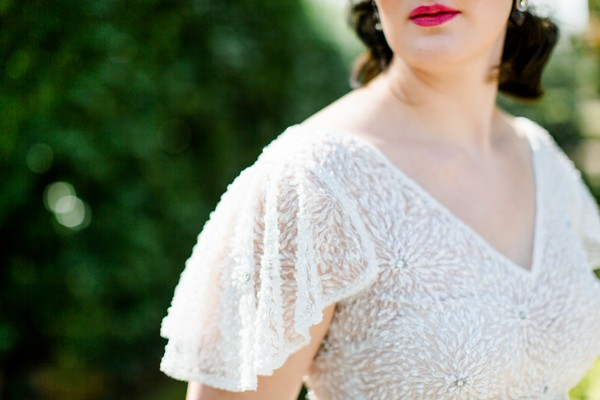 Butterfly sleeves on bride's 1920s style wedding dress