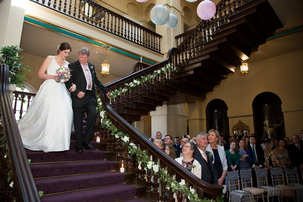 Father walking bride down stairs at Kings Weston House