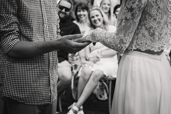 Groom holding bride's hand