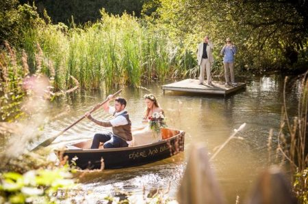 Bride and groom in rowing boat - Picture by Special Day Wedding Photos