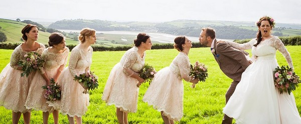 Bridesmaids in a queue to kiss groom - Picture by Paola De Paola Photography