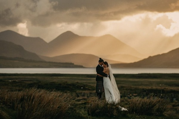 Bride and groom with Scottish hills in background - Picture by John Johnston Photography