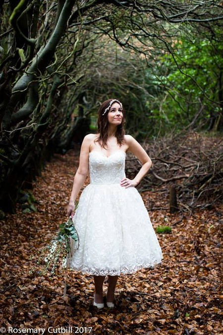 Bride standing in woodland with hand on hip - Picture by Rosie Cutbill Photography