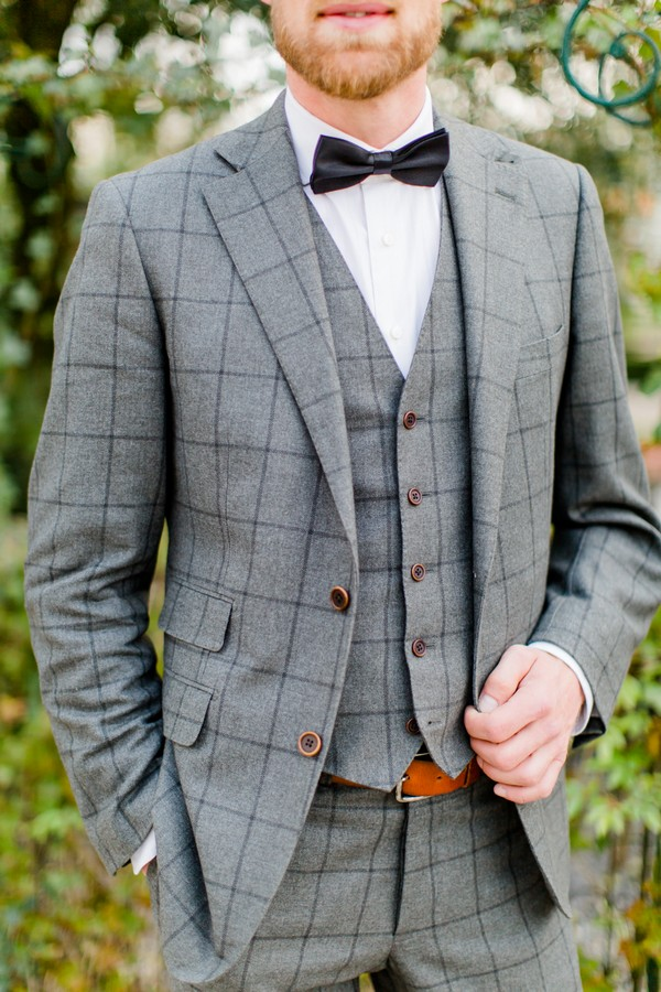 Groom wearing grey check jacket and waistcoat