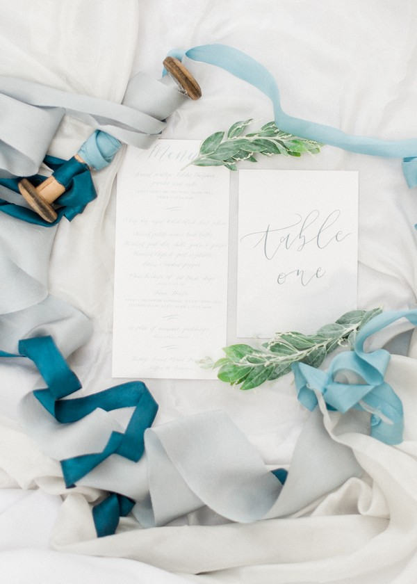 Wedding stationery and blue ribbons