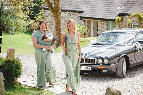 Bridesmaids in long green dresses