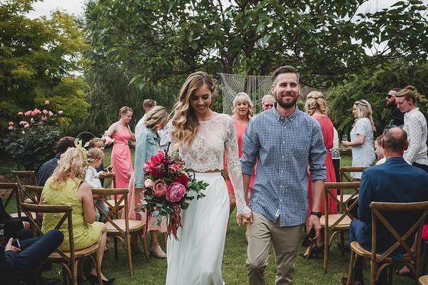 Bride and groom leaving outdoor wedding ceremony