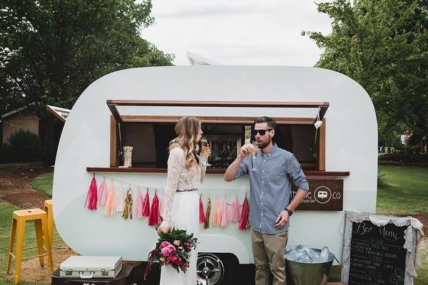 Bride and groom at caravan bar