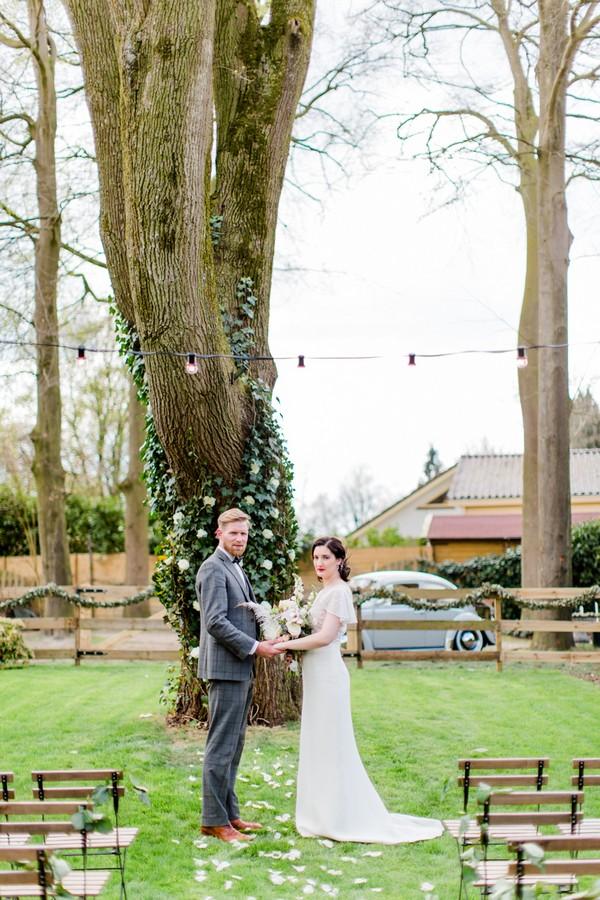 Bride and groom holding hands in grounds of Park Hotel Hugo de Vries