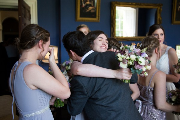 Groom hugging guest at Kings Weston House wedding
