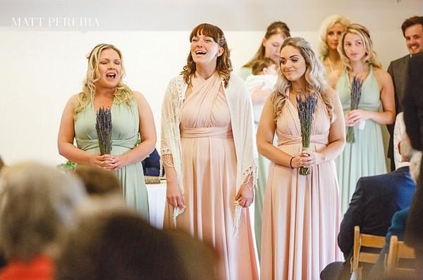 Bridesmaids singing in wedding ceremony