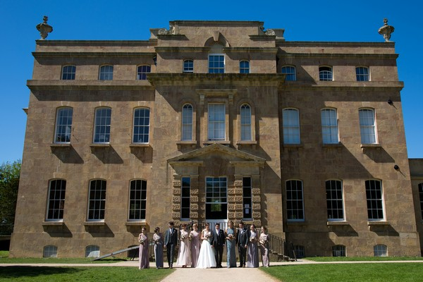 Bridal party outside Kings Weston House
