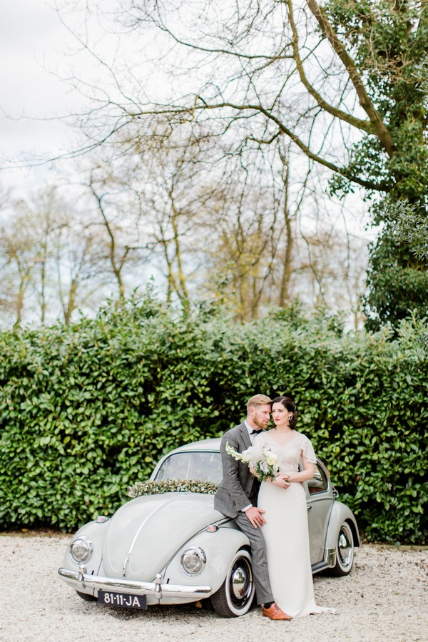 Bride and groom with VW Beetle